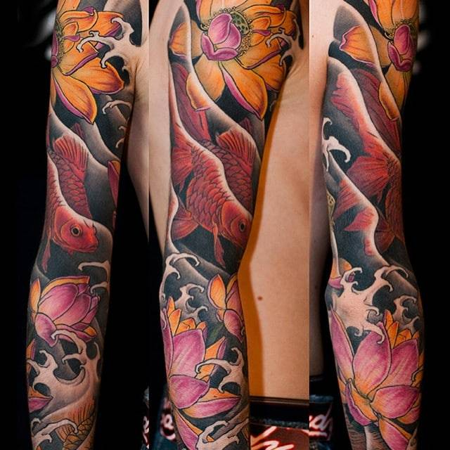 Golden fishes and lotus tattoo
